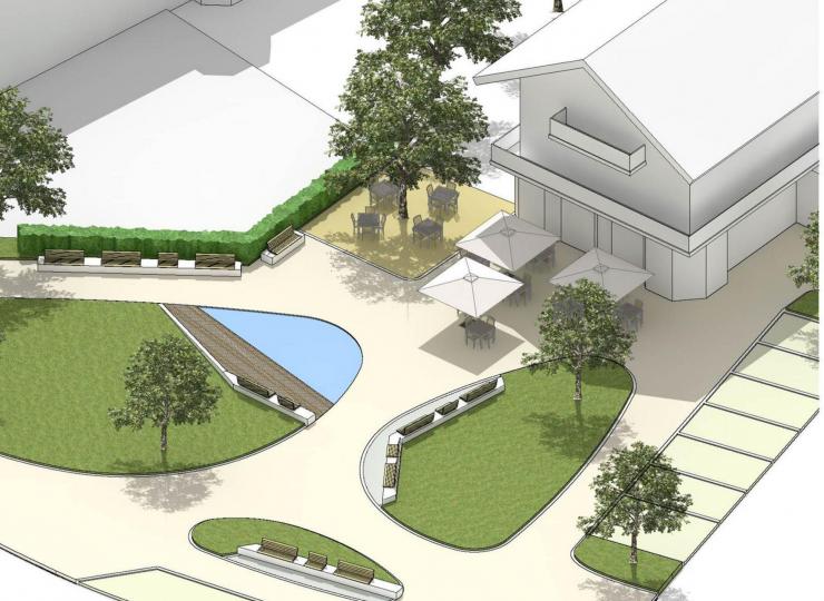 Frei begehbare Wasserfläche, hölzerner Steg und Grünflächen mit Sitzgelegenheiten. Der neugestaltete Lindenplat nach den Plänen des Büro von Angerer.